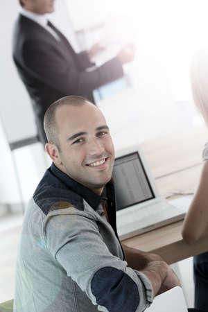 management training: Young man attending management training class