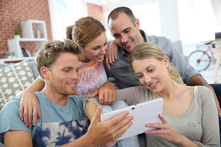 roommates: Roommates in apartment watching tv Stock Photo