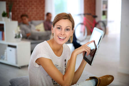 shared sharing: Young woman using digital tablet Stock Photo