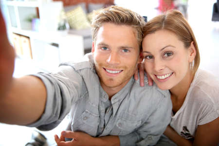 roommates: Friends taking picture of themselves with smartphone