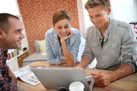 roommates: Roommates studying together at home Stock Photo