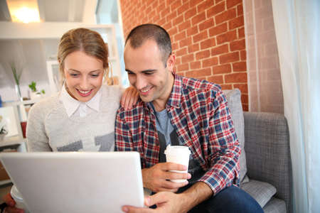 roommates: Roommates at home websurfing on laptop