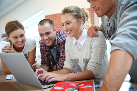 shared sharing: Group of students connected on internet with laptop
