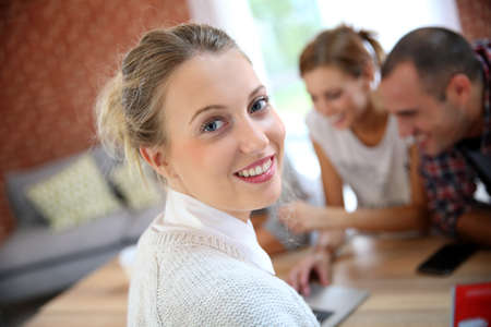 Portrait of student girl, friends in background Stock Photo