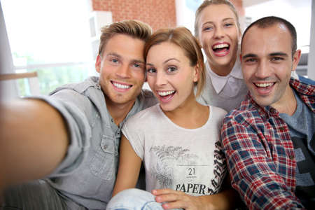 shared sharing: Group of friends taking picture of themselves