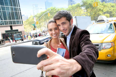 selfy: Couple in New York city taking picture with smartphone