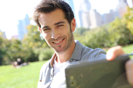 Man taking picture of himself in Central Park photo