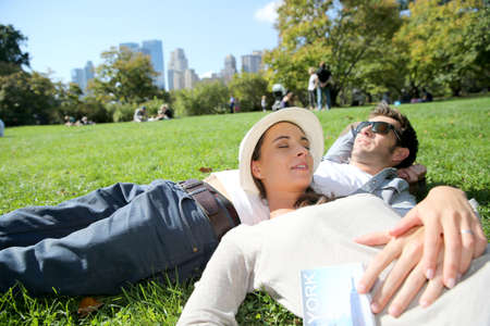 sleeping man: Couple relaxing in Central Park