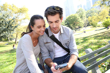 Couple in Central Park looking at pictures on camera