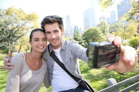 Couple in Central Park taking picture of themselves photo