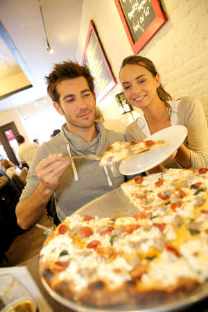 Couple eating pizza in New York city photo