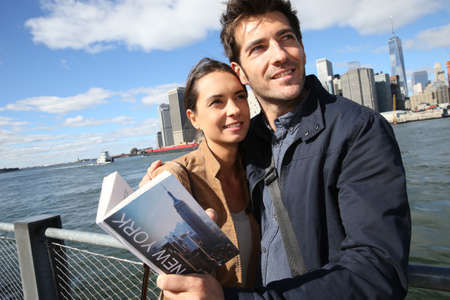 Couple of tourists reading New York city guide photo