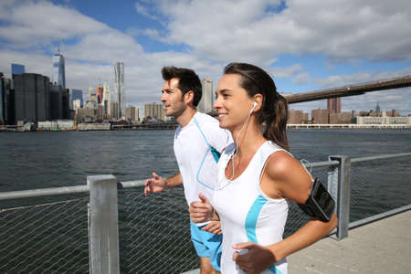 Couple of joggers running on Brooklyn Heights Promenade photo