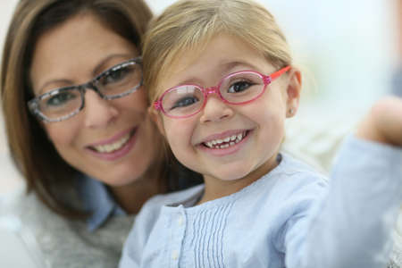 woman wearing glasses: Portrait of mother and daughter wearing eyeglasses