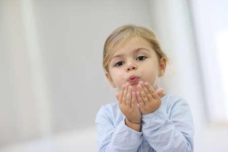 blow kiss: Cute little girl blowing kisses away