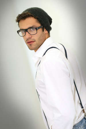 suspenders: Trendy guy with suspenders and eyeglasses, isolated Stock Photo