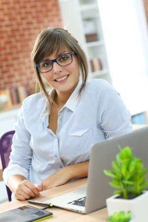 graphic tablet: Creative young woman working in office with graphic tablet