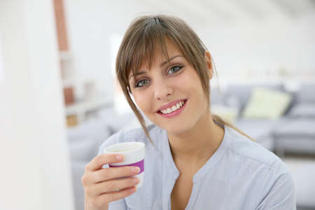 brand new: Smiling young woman standing in brand new apartment