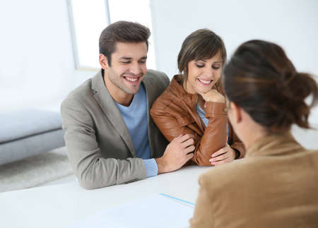 real estate agency: Young couple meeting real estate agent Stock Photo