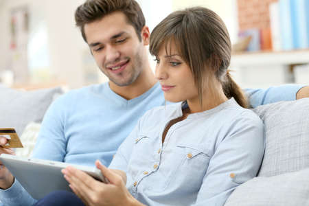 Young couple shopping on internet with tablet photo