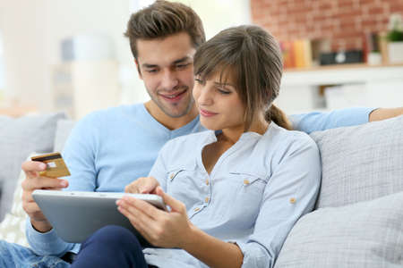 a couple: Young couple shopping on internet with tablet