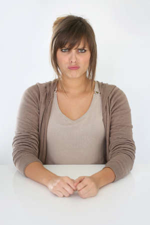 grouchy: Portrait of young woman being grouchy Stock Photo
