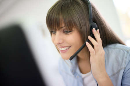 representatives: Customer service representative on the phone Stock Photo