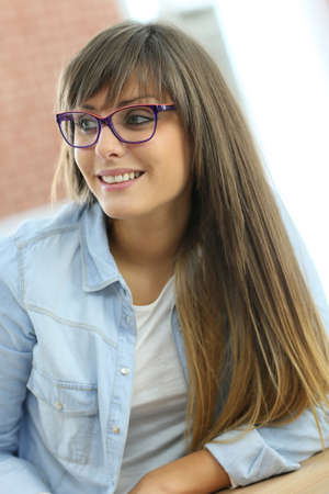 officeworker: Portrait of student girl wearing eyeglasses in class