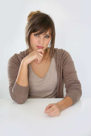 sceptical: Portrait of young woman being skeptical, isolated