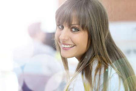 Student girl with long hair looking at camera photo