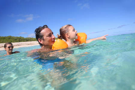 40 year old man: Father and 4-year-old girl bathing in the sea