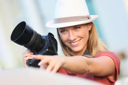 Portrait of woman photographer guiding model photo