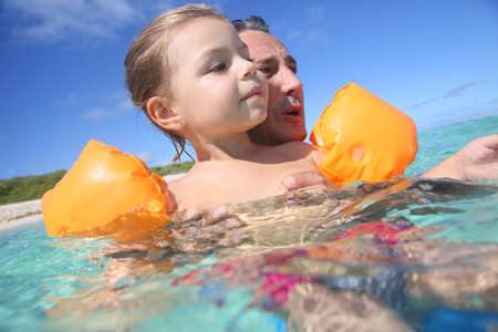 bathe: Father and 4-year-old girl bathing in the sea