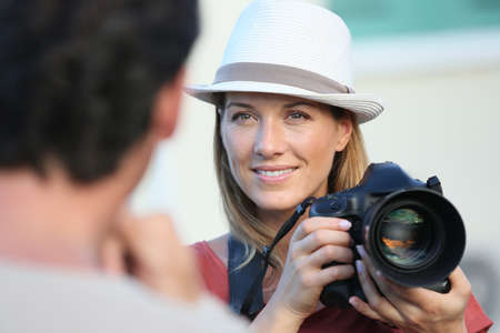 35 years old: Portrait of woman photographer guiding model