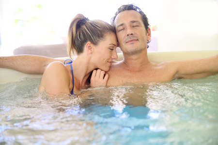 wife of bath: Romantic couple relaxing with eyes shut in jacuzzi Stock Photo