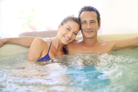 hot tub: Romantic couple relaxing in hot tub