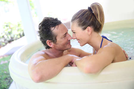 Romantic couple relaxing in hot tub photo