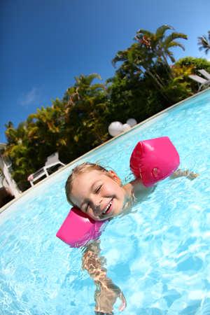 swimmingpool: Cheerful little girl in swimming-pool