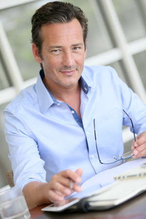40s: Portrait of businessman using digital tablet Stock Photo