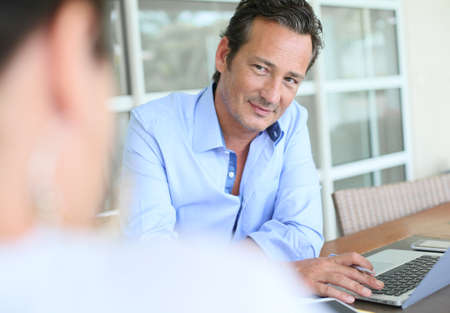 Businessman meeting client in office photo