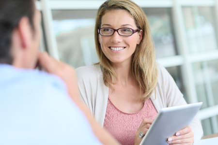 casual meeting: Businesswoman meeting client in office Stock Photo