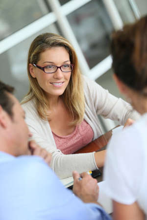 real estate contract: Businesswoman meeting with couple to sign financial contract Stock Photo