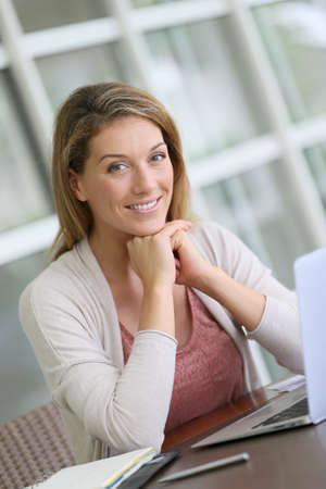 Portrait of middle-aged woman teleworking photo