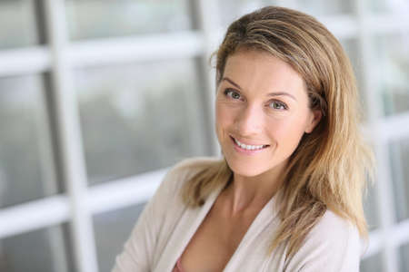 Portrait of beautiful middle-aged blond woman Stock Photo - 34725548
