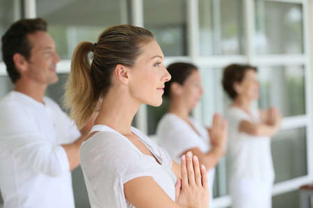 exercices: Group of people doing yoga exercices