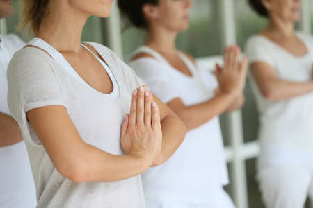 whiteness: Closeup of hands put together on meditation exercise