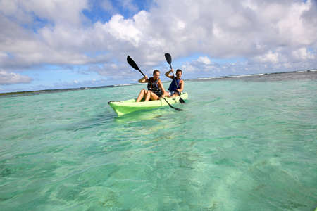 kayaker: Couple canoeing in lagoon of West French indies Stock Photo