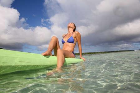 kayaker: Beautiful woman with bikini posing sitted on canoe Stock Photo