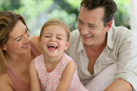 happy little girl: Portrait of happy family laughing together
