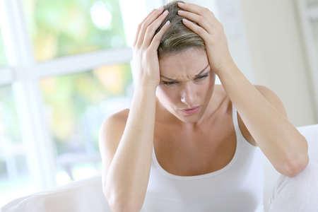 bad feeling: Portrait of woman suffering migraine